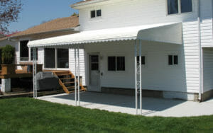 Aluminum canopy with uprights over residential patio in Minnesota
