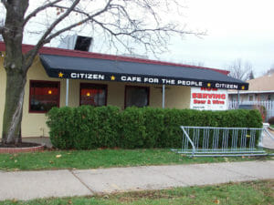 Citizen Cafe used Acme Awning for their canvas patio canopy with graphics and custom posts