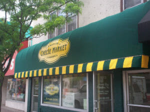 Classic cascade style awning with custom valance by Acme Awning