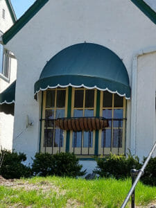 Close up of residential dome awning with scalloped valance