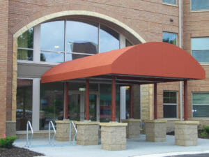 Large half barrel entryway canopy on pillars in Twin Cities