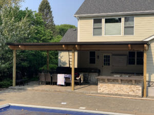 Residential customer with motorized louvered canopy to cover a patio.