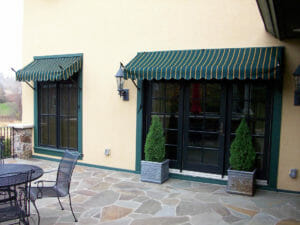 Custom spear Venetian awnings with a striped canvas in the Twin Cities