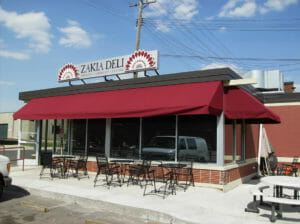 Acme Awning can help you create a covered space for your customer's dining pleasure