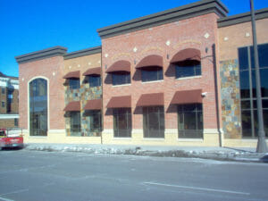 Traditional and rounded awnings on Twin Cities' commercial building