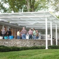 Outdoor kitchen created with louvered roof.